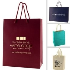 Paper bags in multiple solid colors, ranging from Kraft to Laminated European Tote Style Bags.